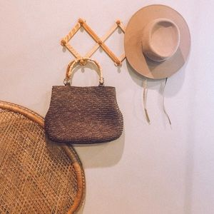 Vintage straw clutch purse with bamboo handles